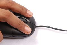 Mouse at work. A mouse with two fingers Royalty Free Stock Images