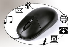 Mouse at work. A mouse is connected to icons Royalty Free Stock Image