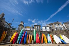 Mousehole Beach And Village With Colourful Kayaks Royalty Free Stock Photo