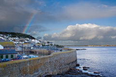 Mousehole in Cornwall. The town of Mousehole in Cornwall, with St Michael's Mount in the background Stock Images