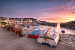 Mousehole in Cornwall. Beuatiful sunrise over the harbour at Mousehole near Penzance on the Cornish coast Royalty Free Stock Image