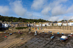 Mousehole Cornwall England UK Cornish fishing village. Mousehole harbour Cornwall England UK Cornish fishing village with blue sky and clouds Royalty Free Stock Photo