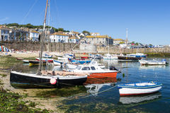 Mousehole Cornwall England UK. Summer at the historic fishing harbour Mousehole Cornwall England UK Europe Stock Image