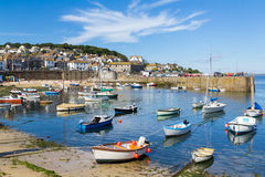 Mousehole Cornwall England UK. Summer at the historic fishing harbour Mousehole Cornwall England UK Europe Royalty Free Stock Images