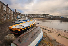 Mousehole, Cornwall. Mousehole: a small picturesque village near Penzance Cornwall, England. Fishing boats on foreground Stock Photos