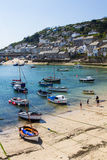 Mousehole Cornwall UK. MOUSEHOLE, CORNWALL, UK - APRIL, 20 2017. The small fishing village of Mousehole in Cornwall, UK is a popular, picturesque travel Royalty Free Stock Images