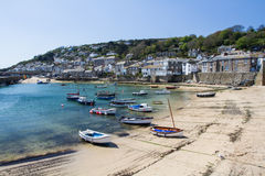 Mousehole Cornwall UK. MOUSEHOLE, CORNWALL, UK - APRIL, 20 2017. The small fishing village of Mousehole in Cornwall, UK is a popular, picturesque travel Stock Images