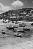 Mousehole Harbour. Boats left high and dry in mousehole harbour, Cornwall Royalty Free Stock Image