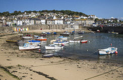 Mousehole harbour in Cornwall. Engalnd, UK at low tide Royalty Free Stock Photo