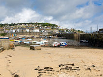 Mousehole harbour Cornwall England UK Cornish fishing village. With blue sky and clouds Royalty Free Stock Images