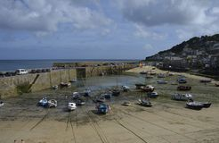 Mousehole Harbour at Low Tide, Cornwall. Moored Boats at Mousehole Harbour at Low Tide, Cornwall, Great Britain Stock Image