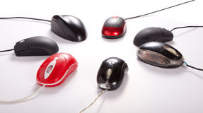 Mouses Meeting. Internet Meeting Creative computer mouses take meeting position Black computer mouses on white background royalty free stock photography