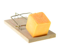Mousetrap. Set with cheddar cheese on a floor, next to a mouse hole Royalty Free Stock Image