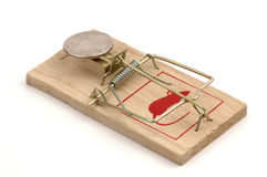 Mousetrap-American Coin. American quarter as bait on a loaded mousetrap Stock Images