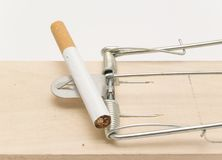 Mousetrap and cigarette Royalty Free Stock Photography