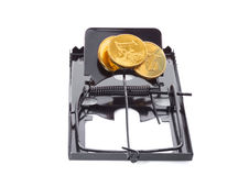 Mousetrap with coins Stock Photo