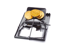 Mousetrap with coins Stock Images