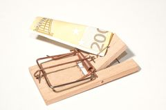 Mousetrap with 200-Euro-Note. As a Symbol for temptation in finance-business Royalty Free Stock Photography
