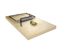 Mousetrap and gold ingots Stock Photography
