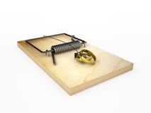 Mousetrap med vigselringar Arkivbild