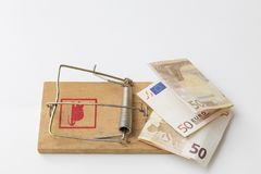 Mousetrap with money to attract the unwary. Mouse trap with two fifty euro notes Stock Photo