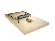 Mousetrap och guldtackor Arkivbild