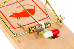 Mousetrap and pill. Isolated on white background Royalty Free Stock Photography