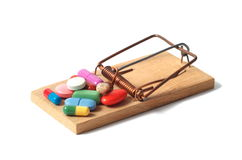 Mousetrap and Pills. Mousetrap with pills isolated on white background Stock Images