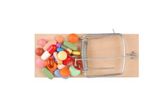 Mousetrap and Pills Royalty Free Stock Photos