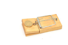 Mousetrap with pound coin Stock Photo