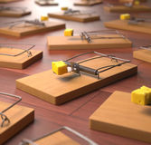 Mousetrap. Several mousetrap with cheese on a wooden floor. Depth of field in cheese Royalty Free Stock Photo