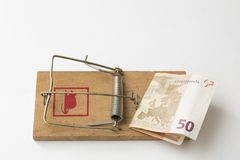 Mouse trap on white background. Mousetrap on wooden board and dock with a fifty euro bill as bait, on white background Royalty Free Stock Images