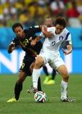 Moussa Dembélé e cupê du monde 2014 de Koo Ja-cheol Fotos de Stock Royalty Free