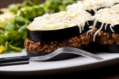 Moussaka. A delicious traditional greek moussaka served with salad royalty free stock photo