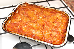 Moussaka. Traditional moussaka - A dish from meat, potatoes, vegetables with the baked cheese royalty free stock photo