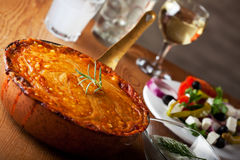 Moussaka. Baked moussaka dish on a wooden board royalty free stock photo