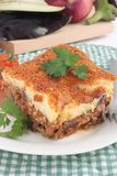 Moussaka. A portion of Greek or Balkan moussaka made with minced beef or lamb, aubergine or eggplant and bechamel sauce royalty free stock photography