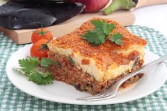 Moussaka. A portion of Greek or Balkan moussaka made with minced beef or lamb, aubergine or eggplant and bechamel sauce stock photos