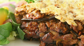 Moussaka 7. Lamb moussaka with egg plant cheese and salad royalty free stock photos