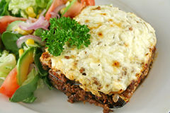 Moussaka 8. Lamb moussaka with egg plant cheese and salad stock photography