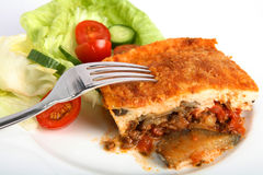 Moussaka dinner with fork stock image