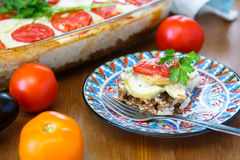 Moussaka dish with aubergine and chili pepper, greek meal royalty free stock photo