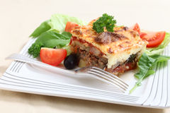 Moussaka and fork Stock Image