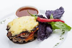 Moussaka of lamb on a white plate royalty free stock photo