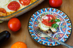 Moussaka on a plate dish with aubergine and tomato, turkish meal stock image