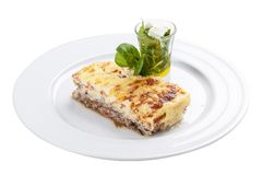 Moussaka. A traditional Greek dish. On a white background royalty free stock image
