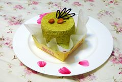 Mousse. Green Tea mousse or matcha mousse with chocolate & apricot kernel Stock Images