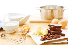 Mousse au chocolat ingredients. Ingredients for a mousse au chocolat including dark chocolate, eggs, butter, cream and sugar Royalty Free Stock Images