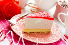Mousse cake with berry jelly. Dessert on Valentine`s Day. Love concept background stock photography