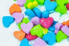 Mousse colorée de coeurs Images stock